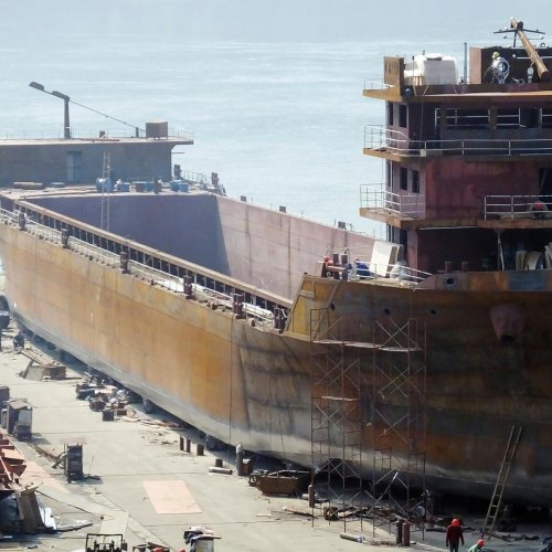 --FILE--Chinese workers manufacture a cargo ship at a factory in Yichang city, central China's Hubei province, 3 March 2019. Orders for China's shipbuilding industry ranked top in the world in the first quarter of this year followed by South Korea and Italy, according to data released by British shipbuilding and marine analysis agency Clarkson Research Services. The research shows China's cumulative order volume for the first quarter reached 2.58 million compensated gross tons or 35 vessels, securing 45 percent of the global market. The shipbuilding order volume for South Korea totaled 1.62 million CGT, or 24 vessels, and Italy reached 780,000 CGT, or 10 vessels. The two countries account for 28 percent and 14 percent of global orders respectively.  (Imaginechina via AP Images)